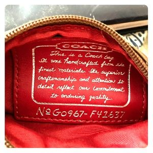 Coach wristlet with popular pattern and red trim